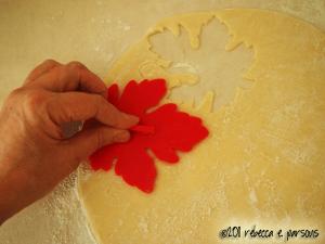 cutting leaves in the tart crust