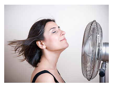 menopause hot flash woman with fan