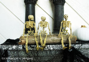 Spooktacular Halloween Mantlescape three skeletons on driftwood