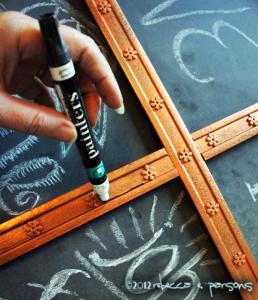 ageing the trim with black Painters marker #GluenGlitterDIY Thanksgiving Chalk Board Tutorial