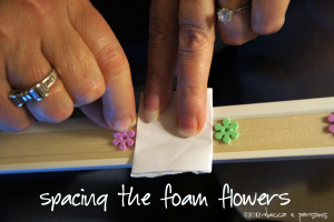 spacing the Flowers on trim #GluenGlitter DIY Thanksgiving Chalk Board Tutorial