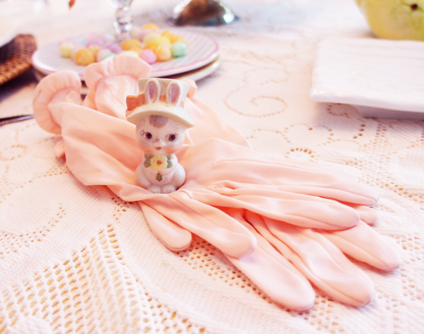 Bunny in pink Easter gloves