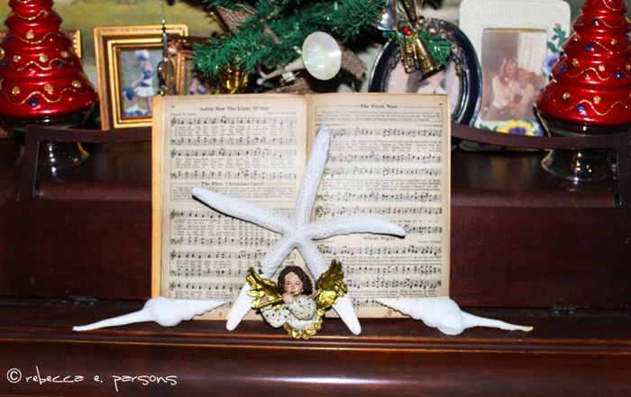 Piano with music and angel playing flute