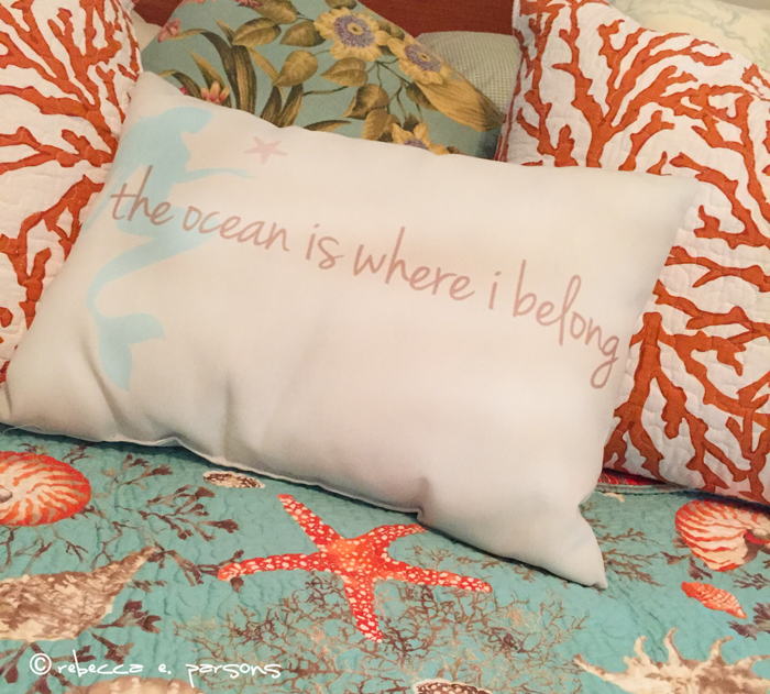 the ocean is where I belong pillow with a mermaid