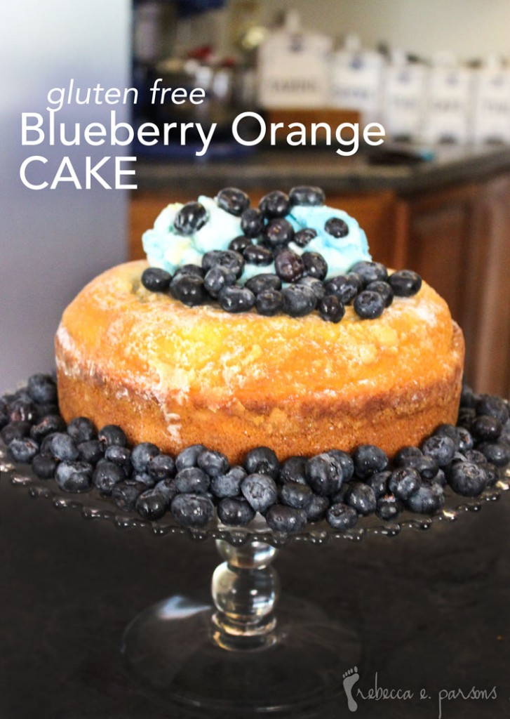 Gluten Free Blueberry Orange Cake decorated and surrounded by blueberries.