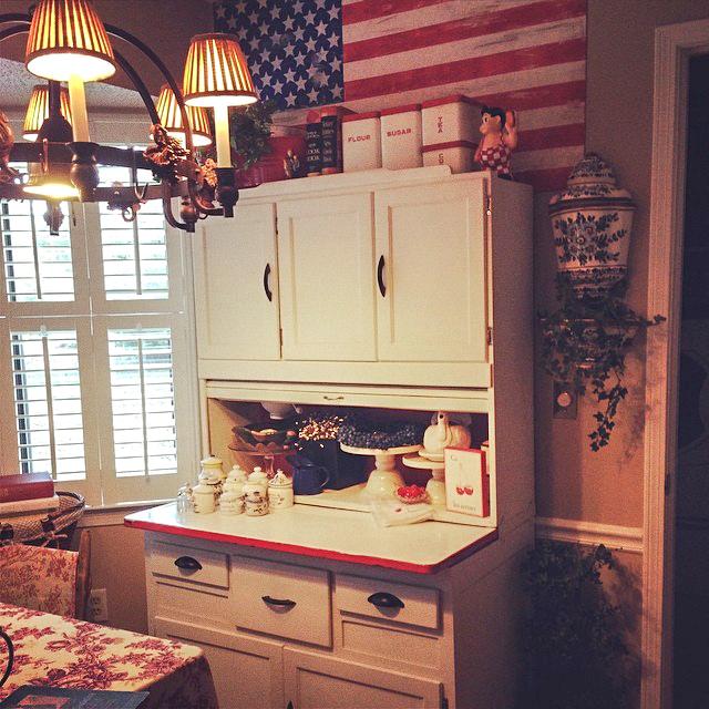 rustic painted American flag over hoosier