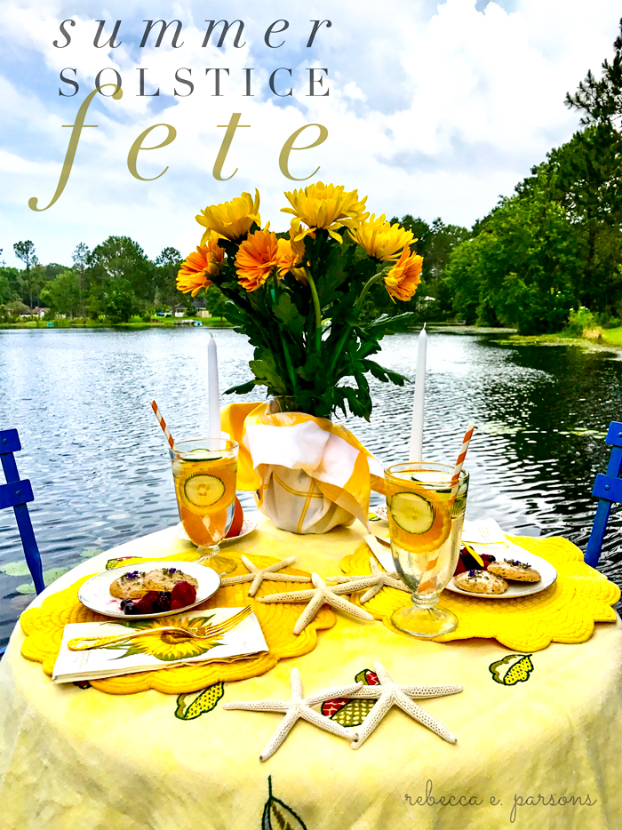 summer solstice fete table by lake