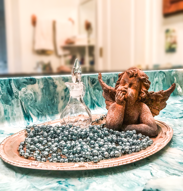 tray with cherub perfume bottle on vanity