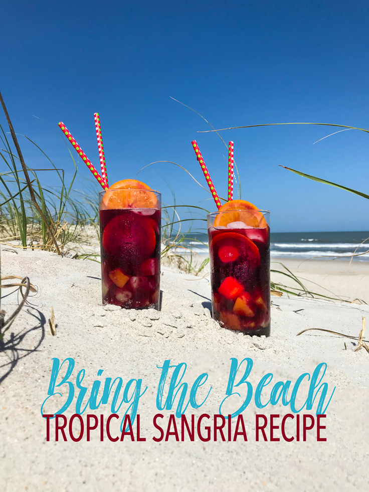 Bring the Beach Tropical Sangria Recipe Glasses in the sand