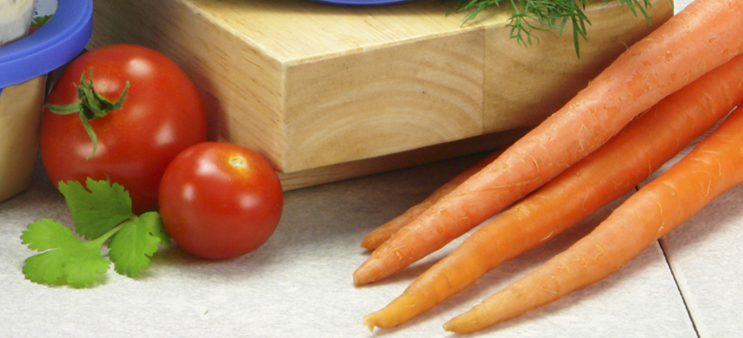 carrots and tomatoes with butcher block healthy eating for baby boomers
