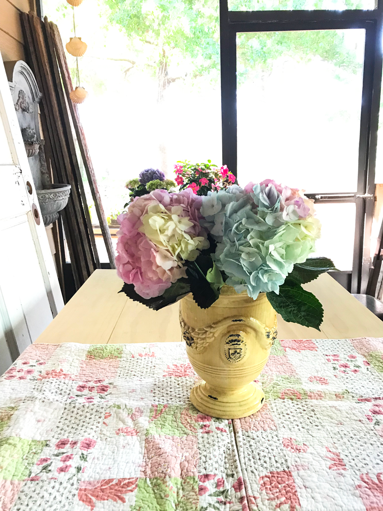 hydrangeas in large yellow bowl on center of table