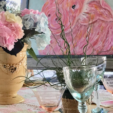 colorful flower centerpiece, pig painting, glassware