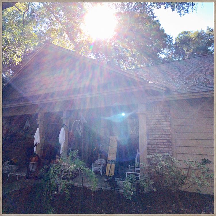 creepy sun rays over porch show off Eerie Entryway Decor for Halloween