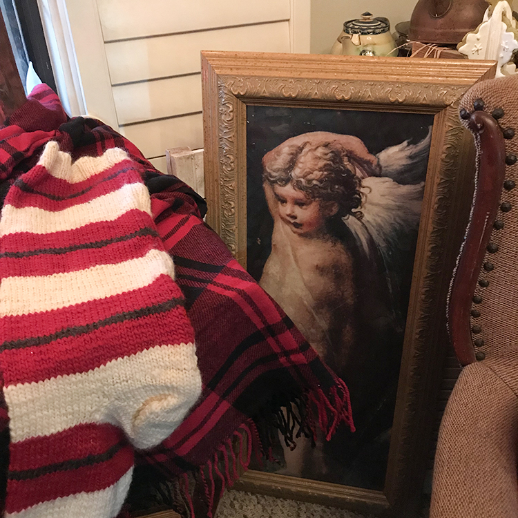 Knitted Stocking and Cherub Painting
